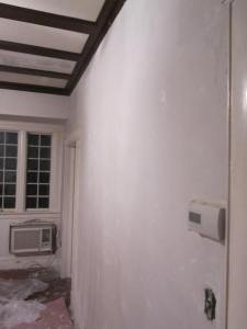 A living room freshly skim coated with plaster